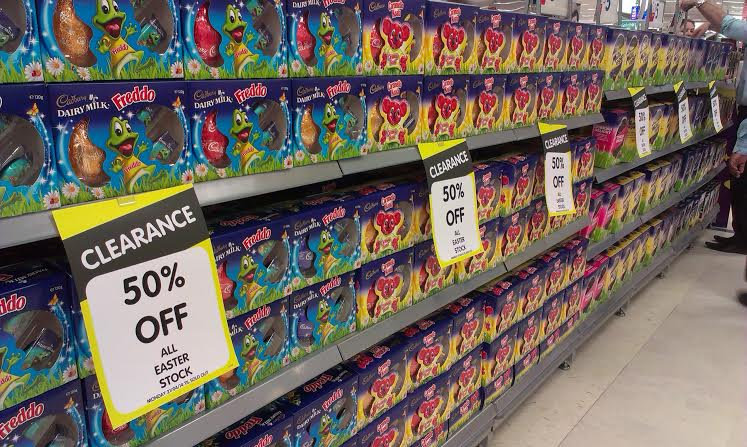 A shopping aisle filled with discounted chocolate Easter eggs