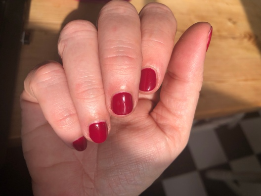 Hand with very red nails